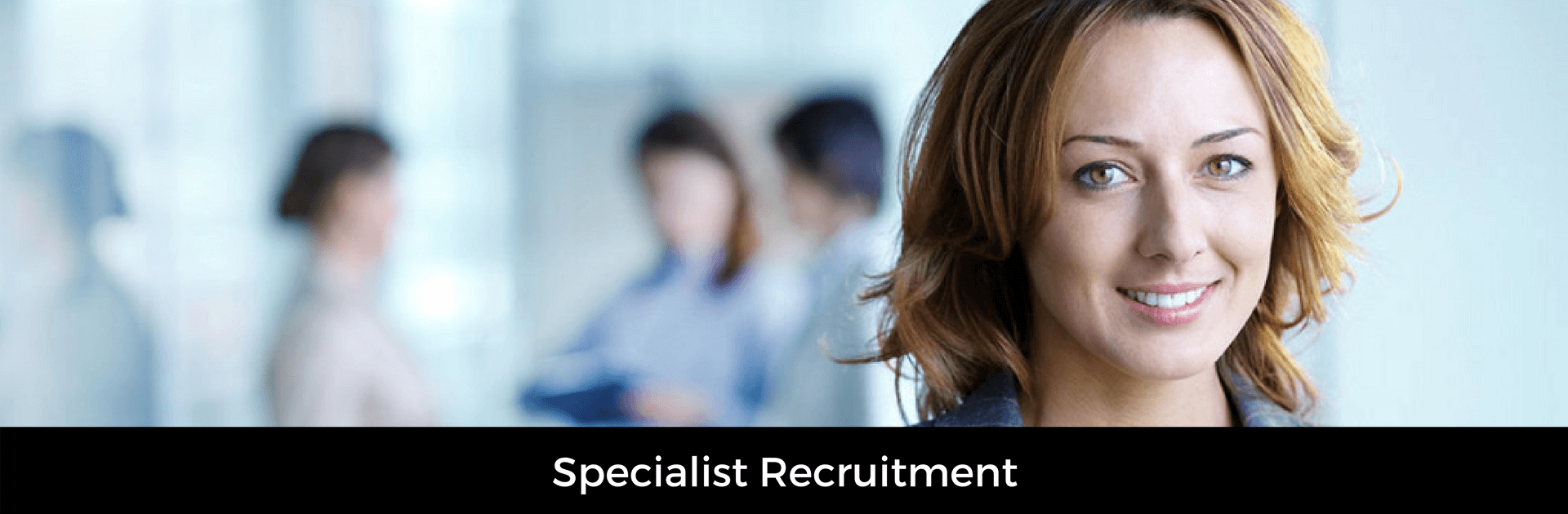 Picture captioned Specialist Recruitment. Background image of a female professional with co workers in the background