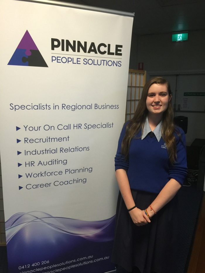 Lions Youth of the Year Winner 2015 pictured in front of Pinnacle People Solutions Banner